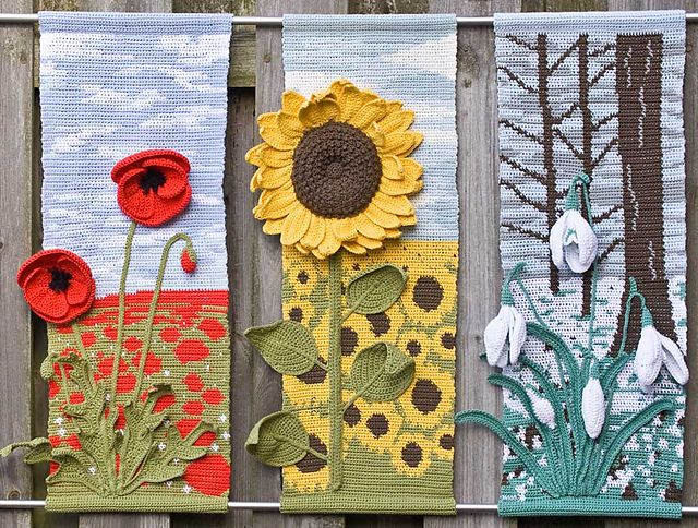 These season floral wall hangings are beautiful with their  colorful tapestry backgrounds and three dimensional details. Check out the rest of Helen Free's work on ravelry: http://www.ravelry.com/patterns/library/four-seasons-hangings---sunflower