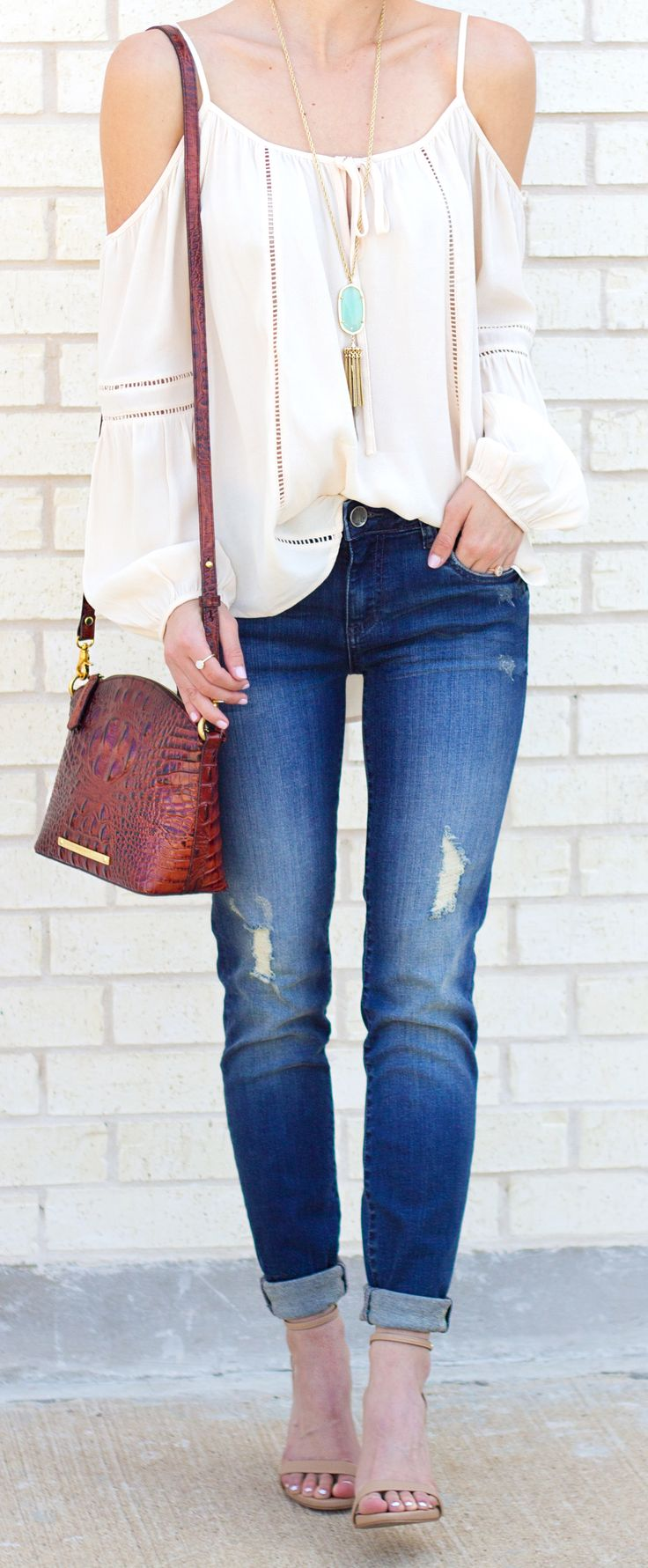 Cold shoulders are really in this spring! Style yours with cuffed jeans and heels or ballet flats.