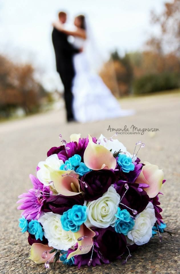"""Bride and groom in background with bouquet in full focus. Not sure how this would look at our venue since I'm not sure what the """"greens location"""" looks like."""