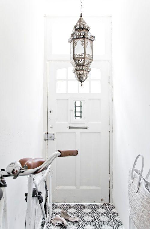 Love the Moroccan lantern in this entryway - via El Ramla Hamra