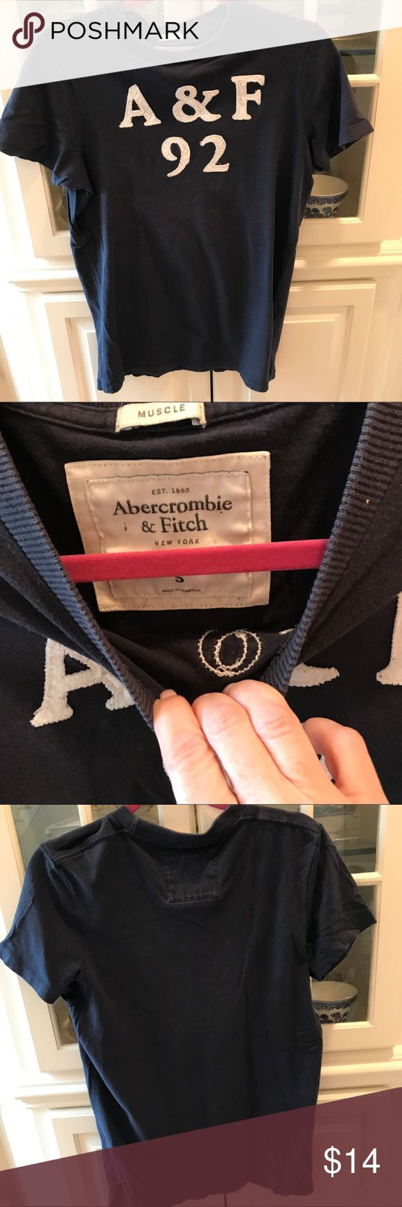 Man/teen Abercrombie Navy T shirt size small T shirt in great condition. I think it was worn once. Muscle size small Abercrombie & Fitch Shirts Tees - Short Sleeve