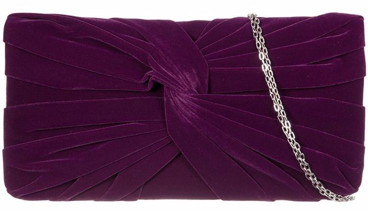 A purple velvet style clutch bag shoulder bag with twist detail to the front The bag fastens with a flap over the top and a concealed metal magnetic
