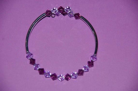 Elegant yet still affordable!  Purple Swarovski Crystal bracelet by Tazzmck on Etsy