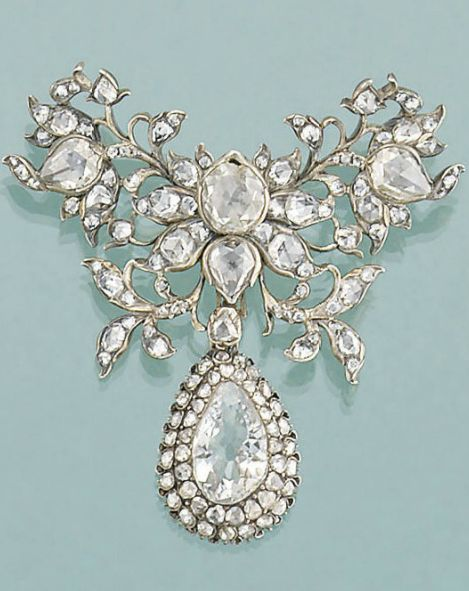 A late 18th century diamond brooch. The closed-set rose-cut diamond butterfly shaped foliate cluster suspending a later 19th century pear-cut diamond and diamond cluster drop  Gorgeous!