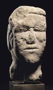 A CELTIC STONE HEAD CIRCA 1ST-2ND CENTURY A.D.