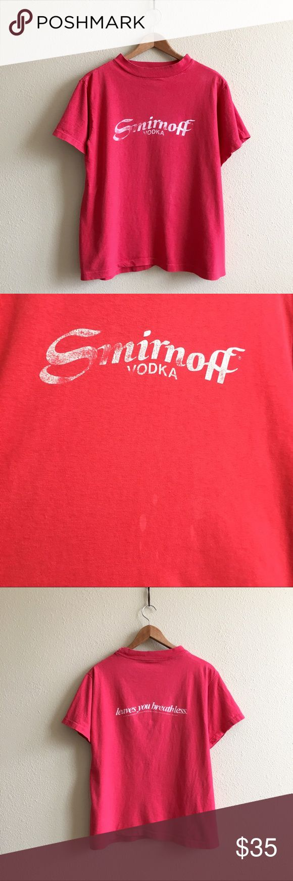 '82 / Smirnoff Vodka Tee Super soft red Smirnoff tee. Has a few small bleach marks on front as shown. This is a true vintage shirt, not a modern reproduction. Sizes vary on vintage pieces, so please use measurements for best idea on fit.   BRAND: - MATERIAL: 50/50 YEAR/ERA: 1982 LABEL SIZE: - BEST FIT: M  MEASUREMENTS: Chest 20.5 inches Length 25 inches  → Style inspiration: James Hetfield, 1983 ☒ I do not model or trade, sorry! ❁ Check out my closet for more vintage! Vintage Tops Tees…