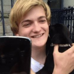 "This is Jack Gleeson a.k.a. King Joffrey from ""Game Of Thrones"" kissing an adorable puppy named Debbie. 