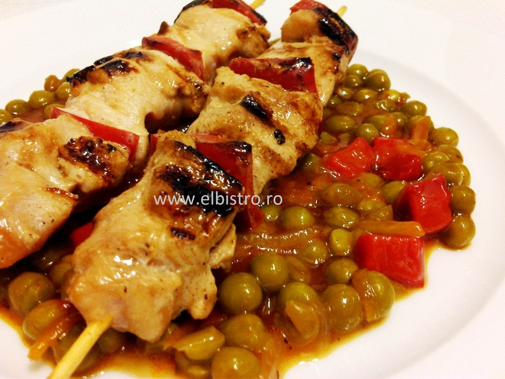 Chicken skewers and peas