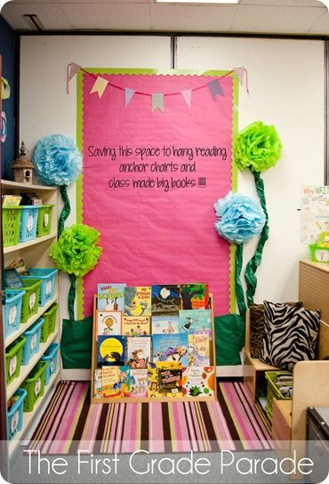I really love how cozy this classroom library is! Saving space for anchor charts is so smart, too :)