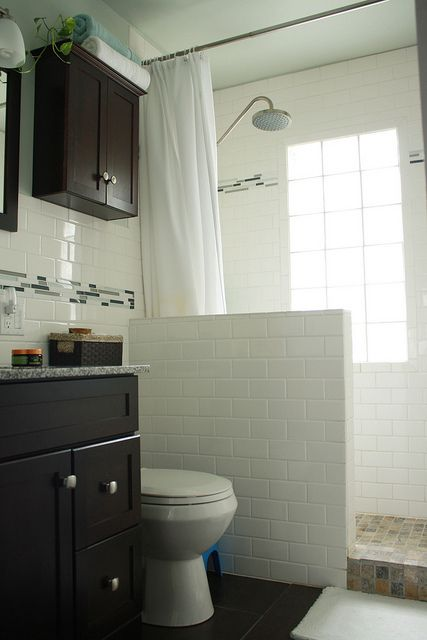 The colors don't excite me but the idea of a partial wall as part of a tub-to-shower conversion definitely does!