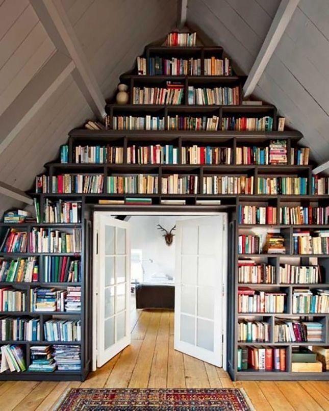 Customized floor to ceiling bookshelves surround the door. Beautiful!