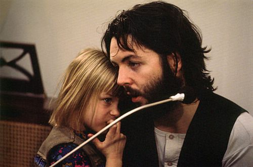 26th January 1969. Paul with Linda's daughter Heather during a break in rehearsals at Apple.
