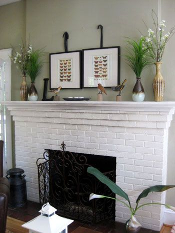 painted fireplace; I really like the light and airy background color with this white fireplace and black iron accents