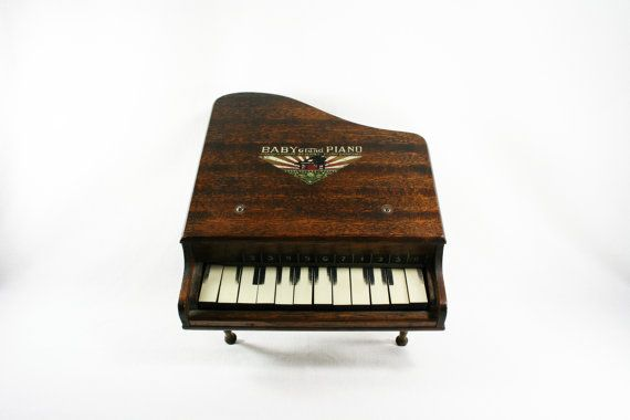 Vintage Childs Toy Baby Piano Company Baby Grand Piano. $40.00, via Etsy.