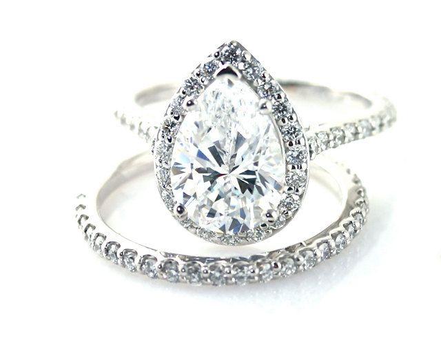 Moissanite Wedding Set Engagement Ring Diamond Halo Custom Pear Setting 14K 18K White Yellow Rose Gold Platinum Bridal Jewelry. $2,934.00, via Etsy.