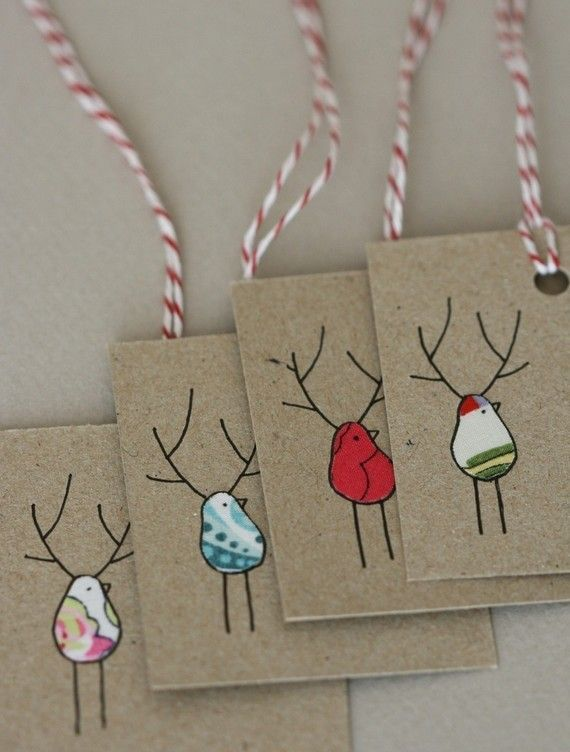 tags made with kraft cards & scraps of fabric. details are drawn on.
