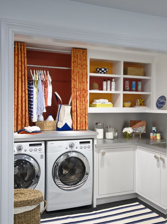 Smart #laundry room layout. Loving the short #curtains to conceal hanging #clothes!