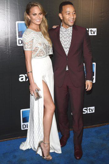 Best Shod Couples: Chrissy Teigen and JohnLegend  Just because John Legend was at the Super Bowl to work doesn't mean he and Chrissy didn't seem to have a blast all weekend in Phoenix, all while looking impeccable. She's wearing Stuart Weitzman sandals to show off those incredible legs.