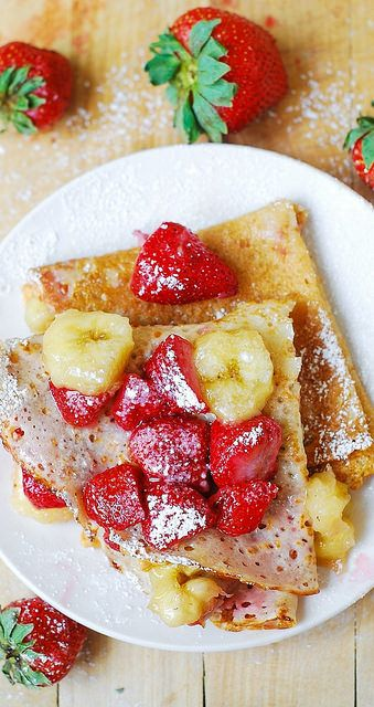 Delicious Homemade Crepes with strawberries, banana, and peanut butter