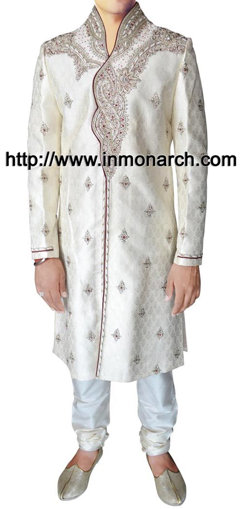 Luxurious mens sherwani made from cream color brocade fabric. Hand embroidered as shown. It has bottom as chudidar made from dupion fabric in white color.