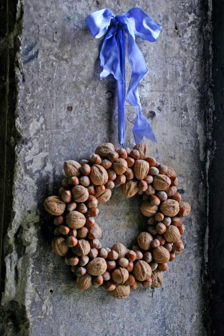 This is a very easy wreath to make, just hot glue, straw wreath form and lots of nuts.
