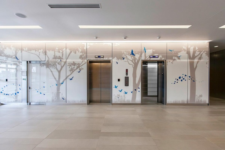 LEVELe Wall System with Blind panels; insets in ViviGraphix Spectra glass with custom graphic interlayer and Standard finish at Nationwide Children's Hospital - Research Building III, Columbus, Ohio