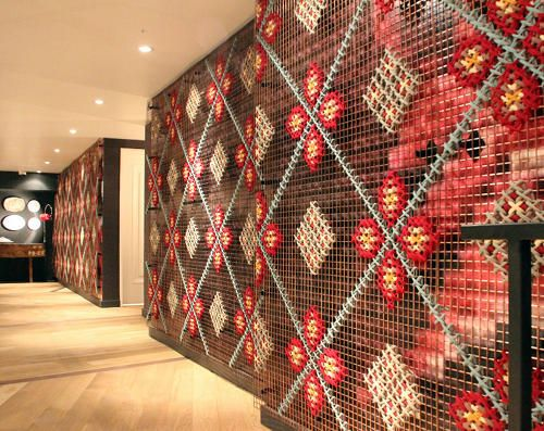 Full wall cross-stitch installation at Patria Restaurant in Toronto - We think this looks really quirky and fascinating. #interiors #inspiration