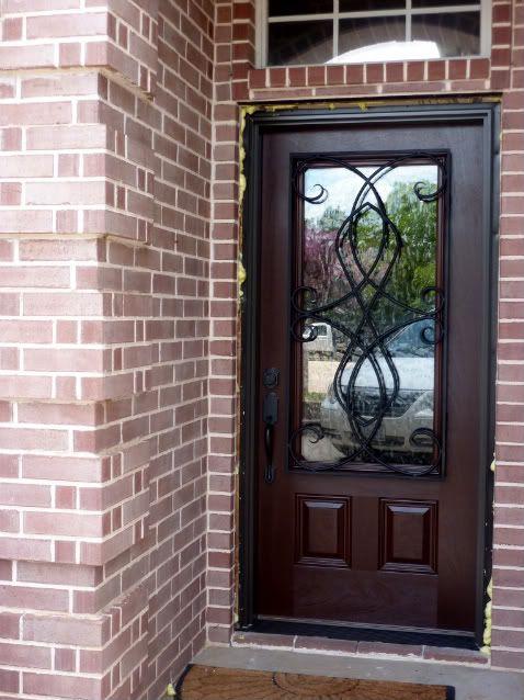 pella door with wrought iron