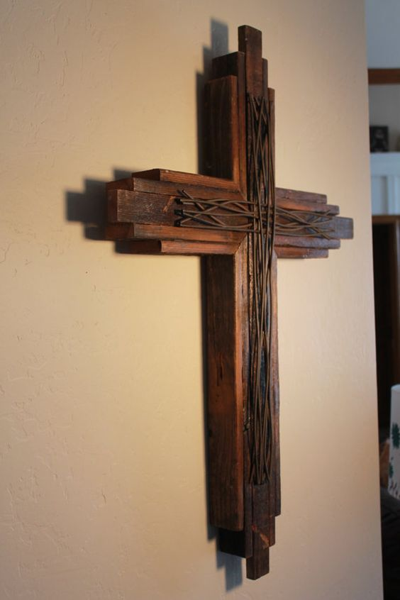 SALVAGED CROSS  Cross is made of fences blown down during storms in the Oklahoma City area.  Cross can be natural/stained. No two are alike. May vary slightly. The one pictured has stained warm wood tones of pecan. This one is 33 tall by 22 wide and extremely durable. Boards are nailed with approx 15 nails and heavy duty glue. This cross will not fall apart. D hook on back for hanging. Indoor or outdoor use.  This cross DOES NOT have a glossy look. It is a matte finish.  NOTE: Base stand not…