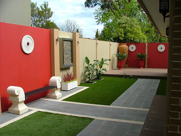 a courtyard masterpiece using boldly painted SlimWall panels.