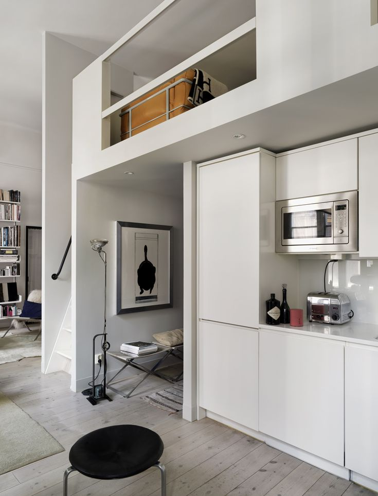 Kitchen with storage and a loft