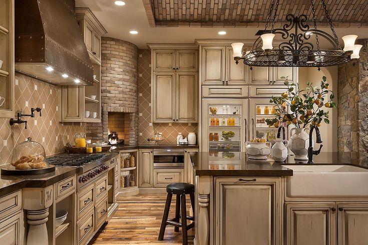 Corner stone fireplace in kitchen!!,....Southwestern Ranch - Luxury Calvis Wyant Homes