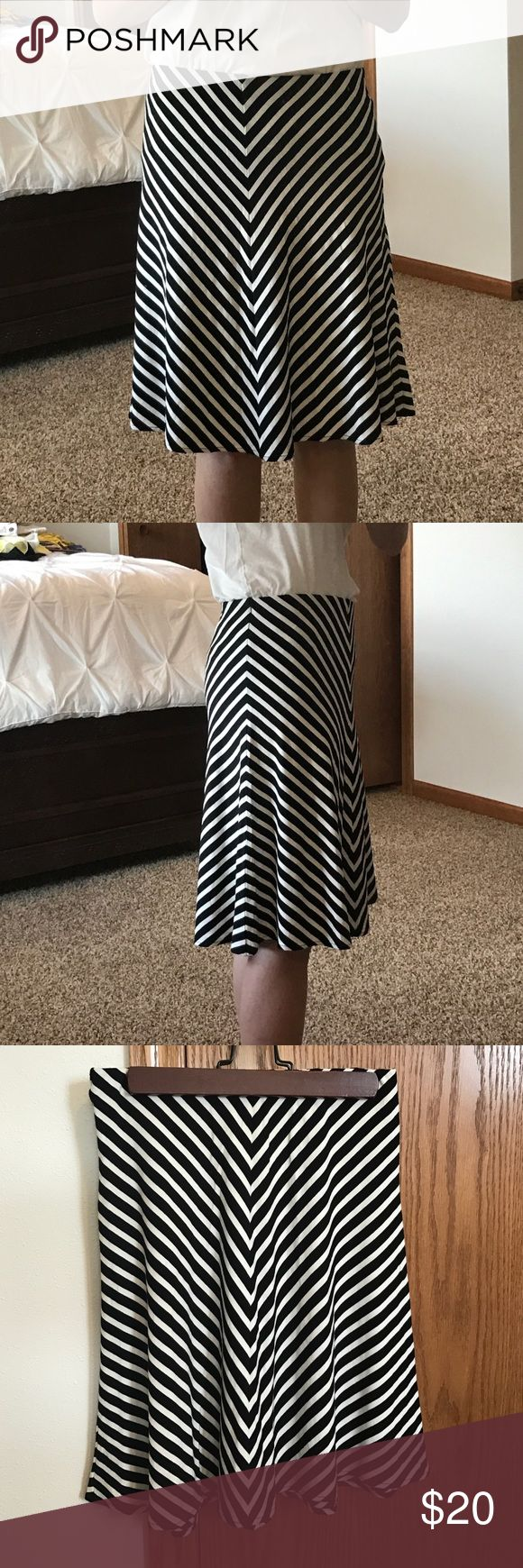 XXSpetite Ann Taylor Black and white skirt Ann Taylor Loft Petites Black and white stripped rayon a-line skirt. This skirt is super cute and would be great casual or you could dress it up. It is in excellent condition! Ann Taylor  Skirts A-Line or Full
