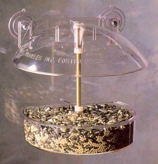 """W1 Winner Feeder  The Winner Window Feeder. 6.5"""" diameter. .5 seed capacity. Made of UV stabilized polycarbonate. Open construction. Suction cups. Curved rim. Deep dish. Drainage holes."""