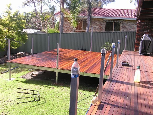 Decking boards installed and posts to handrail height.