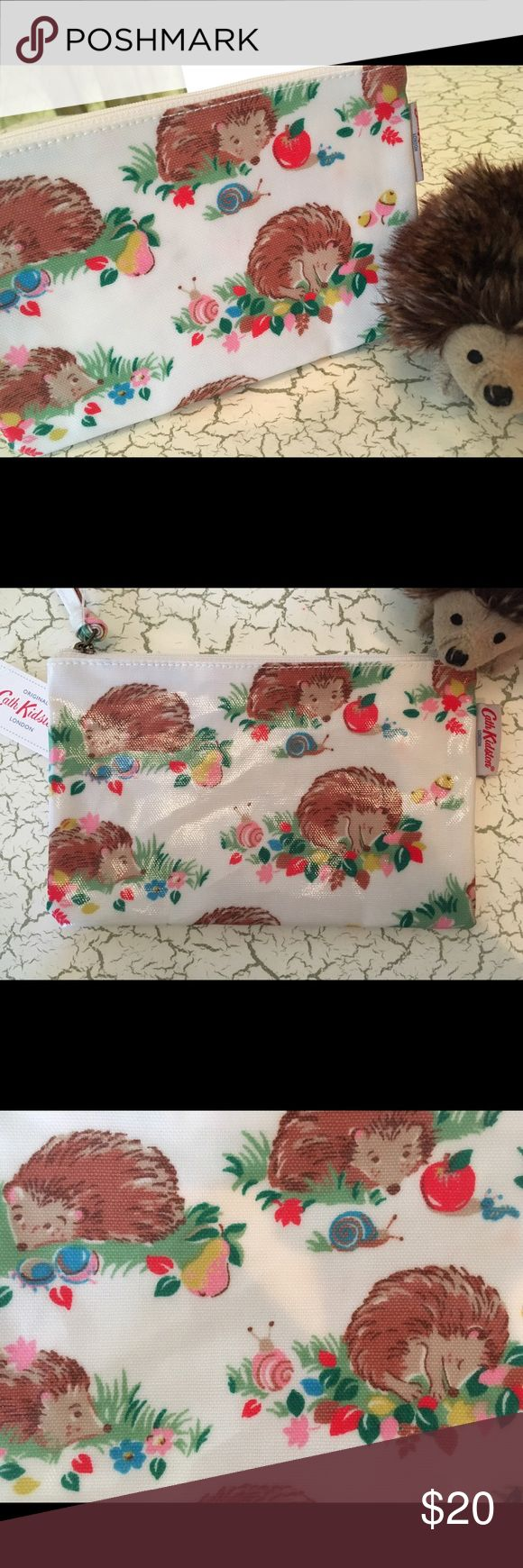 """Cath Kidston Hedgehogs Zip Purse New with tags, this is a precious Cath Kidston Hedgehogs Zip Purse. Another crazy-cute piece by UK designer Cath Kidston, known for whimsical prints. Hedgehogs are curled up napping and just hanging out being adorable. Sweet details such as snails, inchworms, acorns, fruit and flora. All on ivory oilcloth that is easy to wipe clean. 7.5"""" x 4.6"""" x .25"""". Use this as a small clutch purse (iPhone, cash & a lipstick or 2 will fit), pencil case, small cosmetics…"""