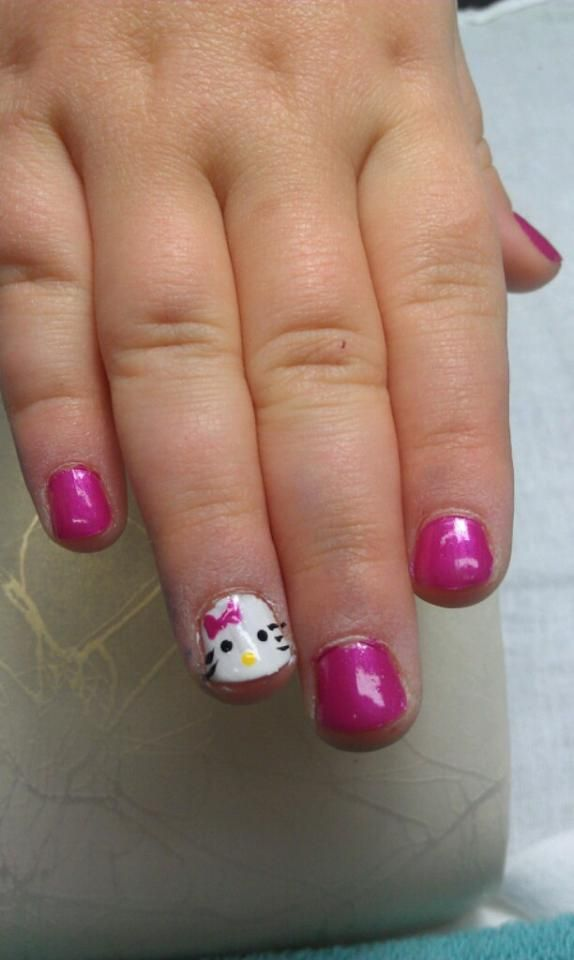 sweet pink hello kitty nails on the cutest little girl