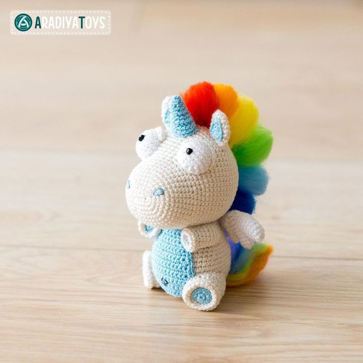 """Unicorn Corki is a design toy, created specially for """"AradiyaToys Design"""" collection.The pattern is available in English (pages 32-62) and German (pages 1-31).Please do not sell Unicorn Corki crocheted with this pattern. If you publish the photos of the toys you made with this pattern, crediting the author is always welcome.Photography by Kate Koleshchuk."""