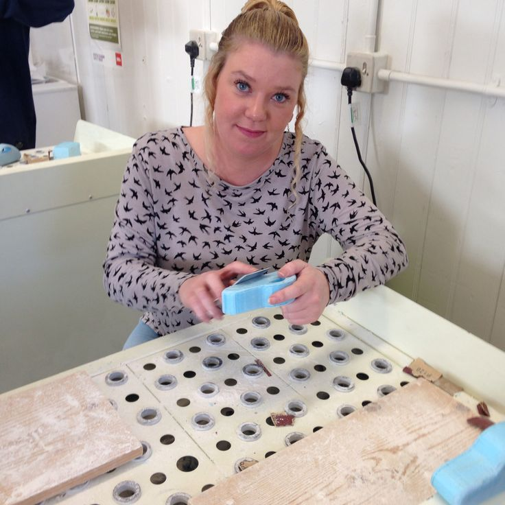 Me sanding down the surface of the foam to create a smooth surface before pollyfiller and plaster