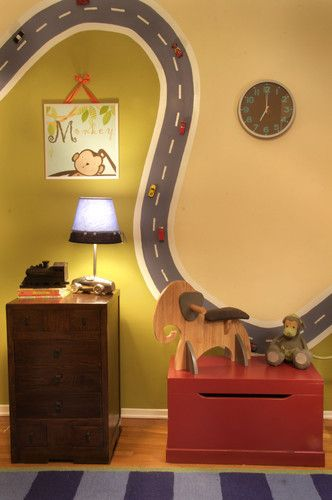 Magnetic Paint on the wall, glue magnet on bottom of car. The BEST idea I have seen for a boys room..