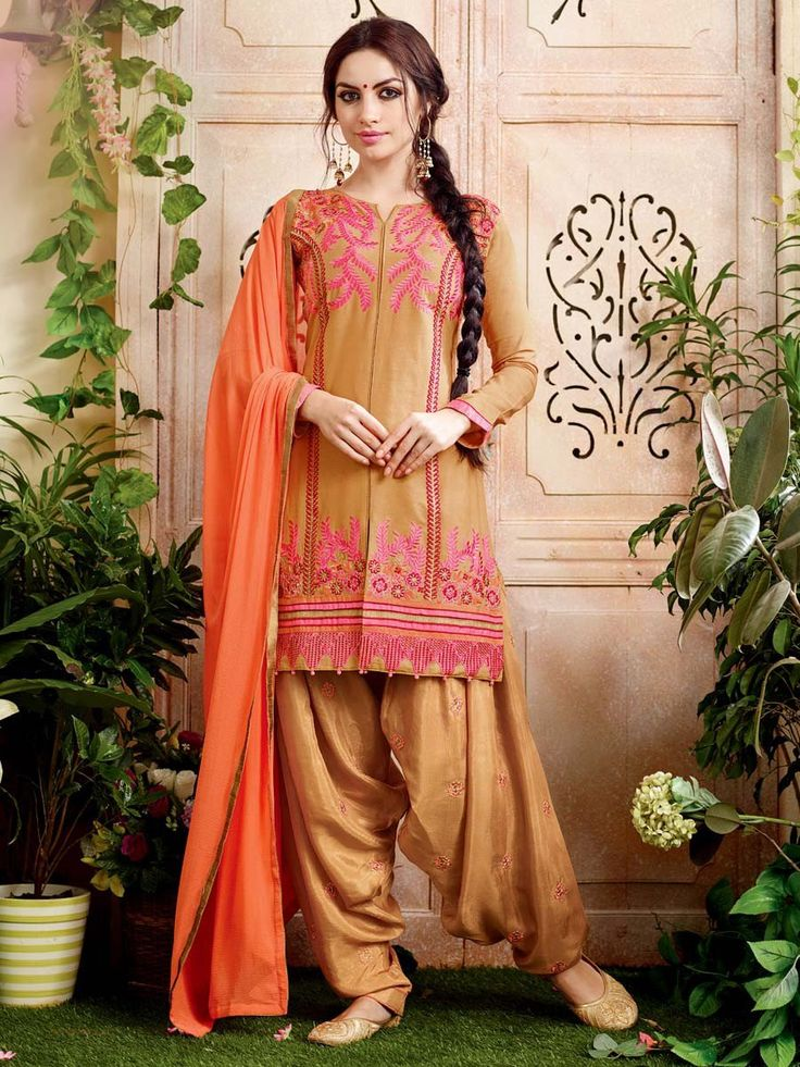 Stunning golden beige color kurta is fabricated on cotton with resham, zari work. Item code: SLNYA701 http://www.bharatplaza.com/new-arrivals/salwar-kameez.html
