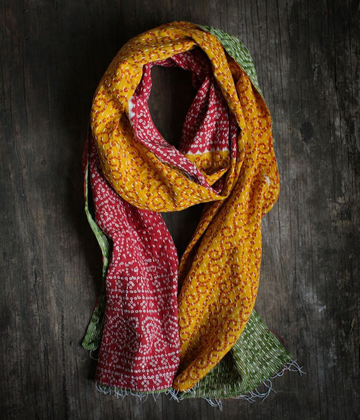 Say hello to India with this soft cotton scarf repurposed from vintage saris. This reversible kantha scarf features a running hand stitch that creates a unique texture and feel to this one-of-a-kind scarf. Textiles don't get better than this!