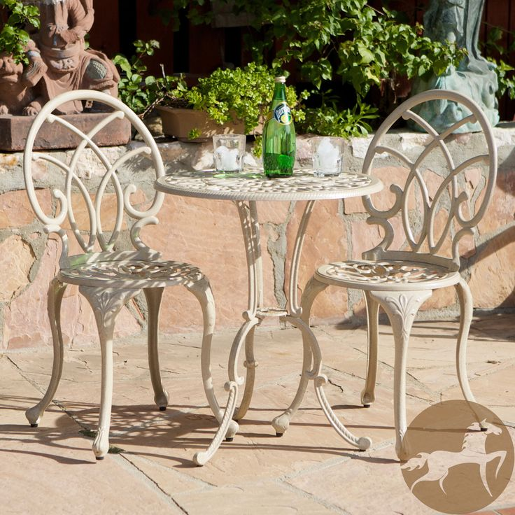 This three piece Anacapa bistro set features cast aluminum construction and an off-white finish. With a table and two chairs, this outdoor set is perfect for your patio, balcony or garden.