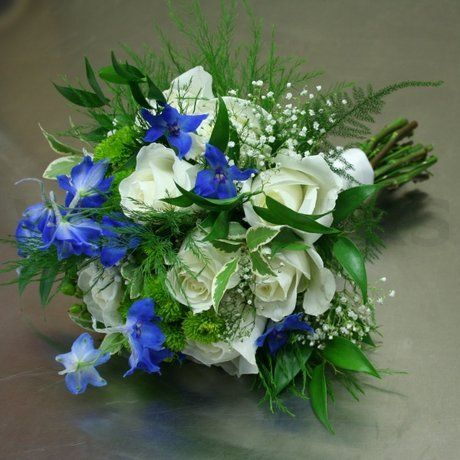 It drives me crazy when florist websites don't identify the flowers in a bouquet. I don't know what all of these are, but I really love this.