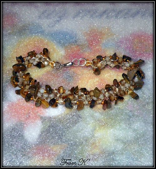 Evening #bracelet. Chic and feminine, this beautiful bracelet is a great addition to your favorite evening outfit. Shades of caramel crystals and Gold Tiger eye gem stones are used to create this bracelet. Wide: 1.5cm Length: 19 cm 25.00 Ron