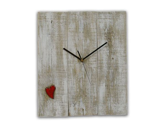 Aldomero White Wall Clock with heart size 30 x 35cm  It is a medium-sized clock Monte Vente made ​​from reclaimed pine wood.  The clock face is integrated ceramic heart  Clock Aldomero with Heart despite its simplicity, has a unique look and charm. On the creation of my products I spend hours of attention, emotion and passion... In each clock there are only positive feelings. More products: www.montevente.pl