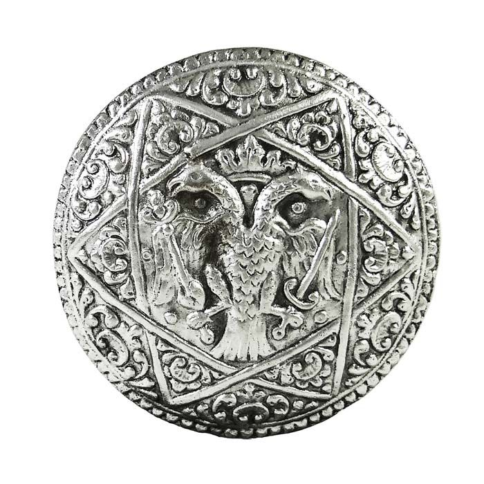 Double-headed eagle, a symbol often found in coats of arms, emblems and flags associated with the Byzantine Empire. It symbolizes the dual power of the emperor, secular and spiritual, and the two heads, the sovereignty of the Byzantine emperors from east to west. Dimensions: 6,5cm diameter x 7mm width Silver-plated Brass.