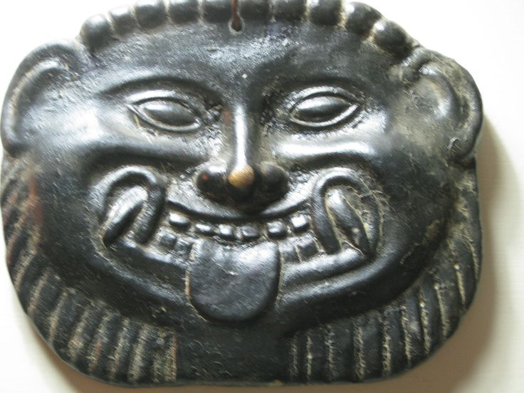 A gorgon mask peered from the shadows... The Etruscan