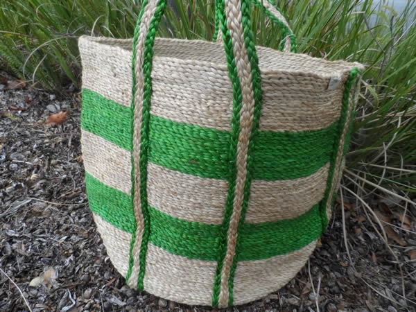 Love this handwoven basket also in red stripe . Made from Jute.