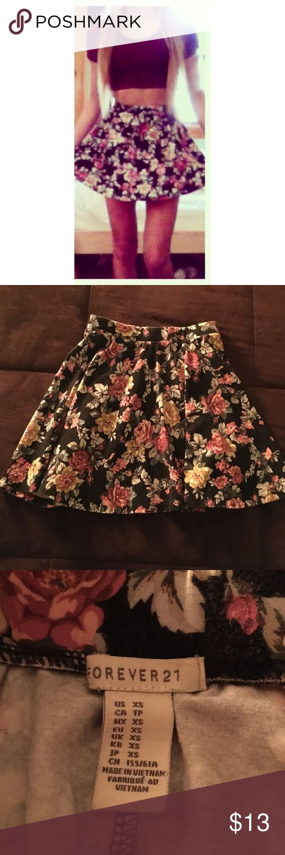 Floral on black high waisted skirt Forever 21. XS fit. High waisted and mini. Very good condition. Forever 21 Skirts Mini